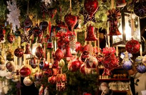 Christmas decorations hanging on a market stall
