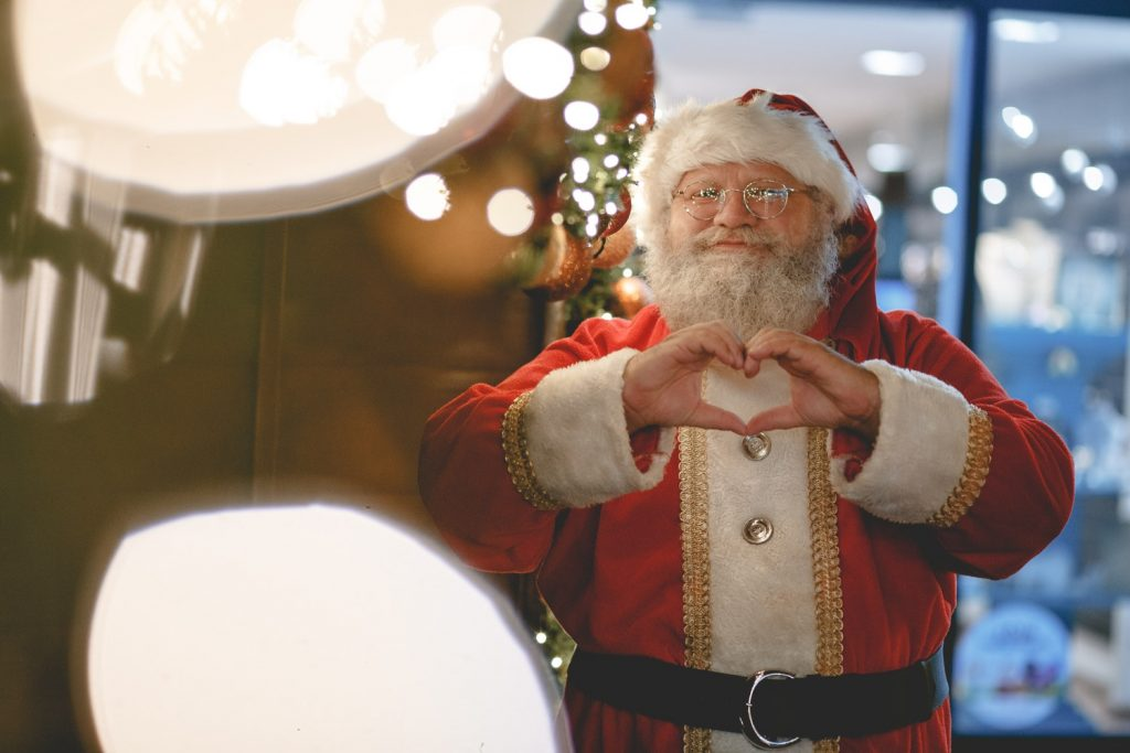 Santa doing heart gesture at a grotto