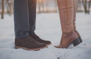 Couple standing in snow