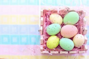 Different coloured Easter eggs in box