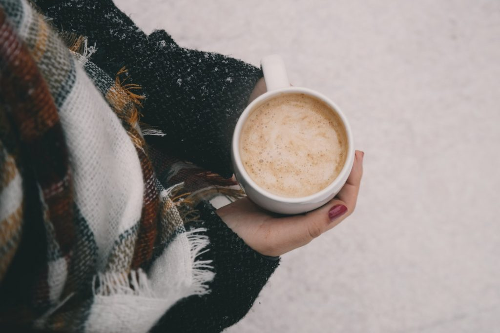 Woman holding a hot chocolate