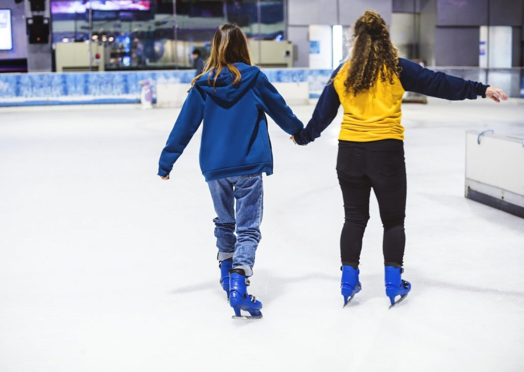 Couple ice skating on an ice rink